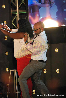 Banky W's dutty wine on stage with fan