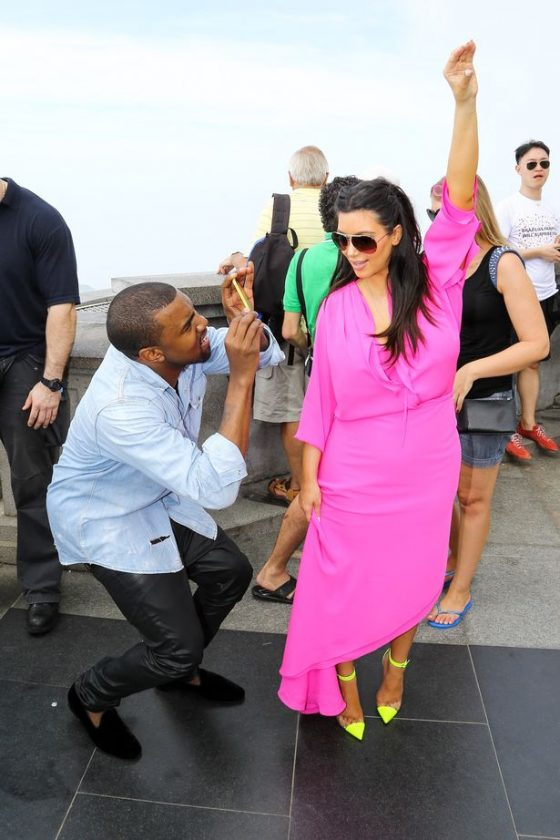 Kim Kardashian and Kanye West enjoy the view from the top of the Corcovado Mountain in Rio de Janeiro