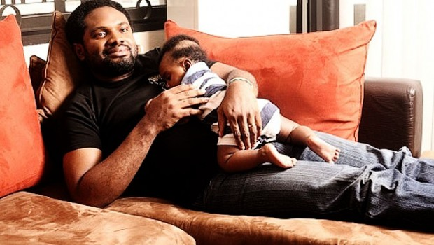Cobhams Asuquo and his baby