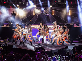 D'banj performing with half naked girls