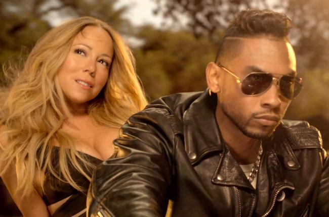 Mariah on the back of motorbike with singer Miguel