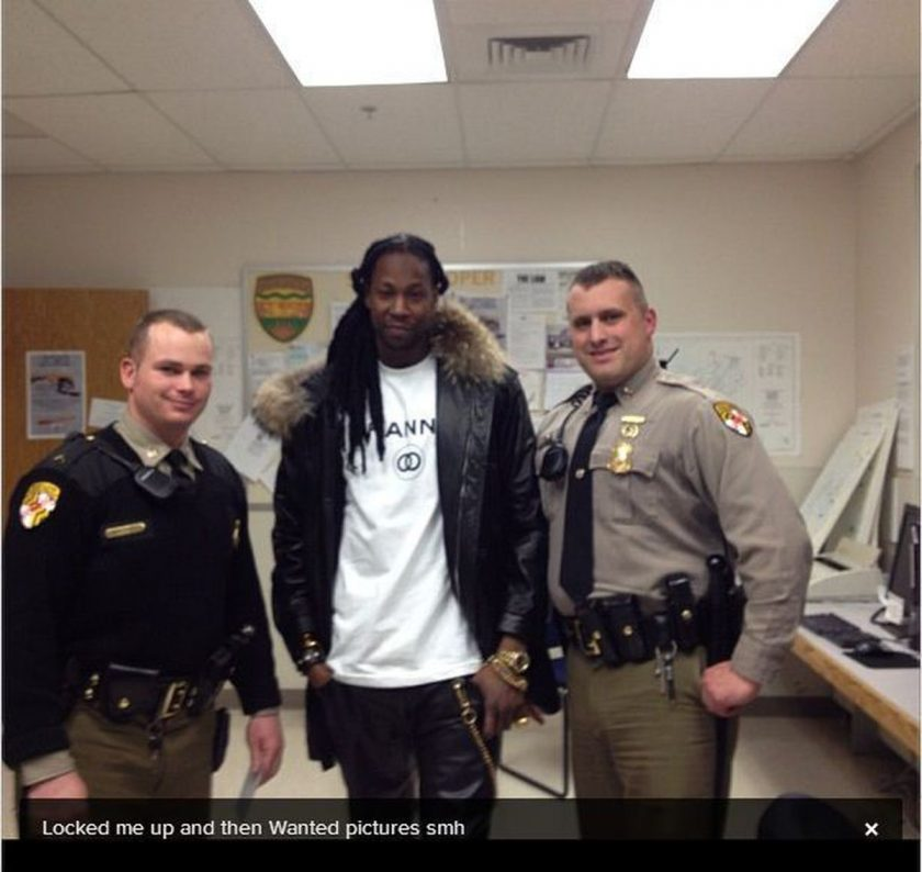 2Chainz poses with cops during arrest
