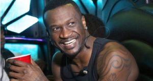 Peter inside of Psquare's luxurious limo truck