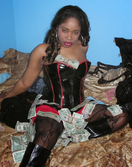 Afrocandy poses with dollars notes
