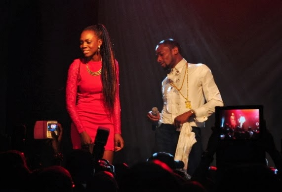 D'banj checks out Beverly Osu's butt on stage