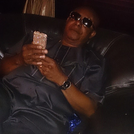 Tonto Dikeh's dad poses with her diamond plated iPhone