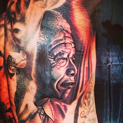The Game tattoos Nelson Mandela's face on his body