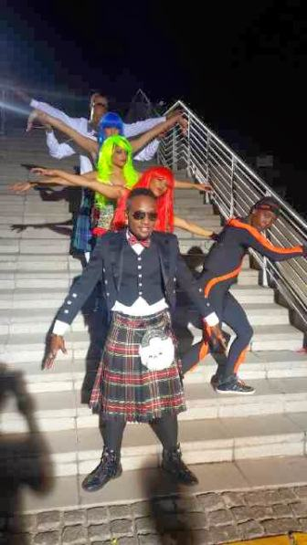 KCee rocks skirt in new video shoot