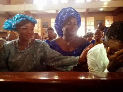 OJb's 3rd wife consoling him while the 1st wife looks on during Thanksgiving service