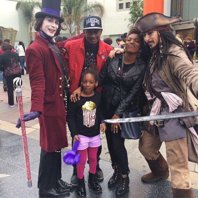 Annie, Isabella & Charles Idibia strikes a pose with Jack Sparrow