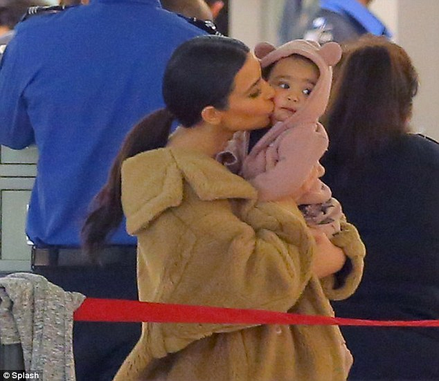 Kim K kisses and North West