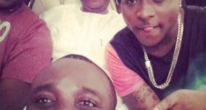 Davido poses for a selfie with dad