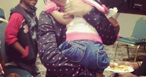 Isabella Idibia carrying her sister Olivia
