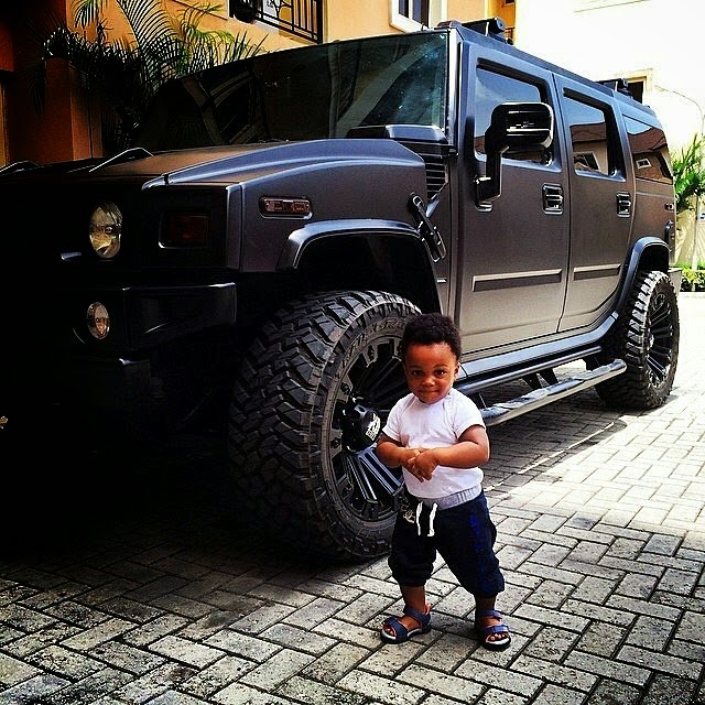 Andre poses with Uncle Jude's new hummer beast