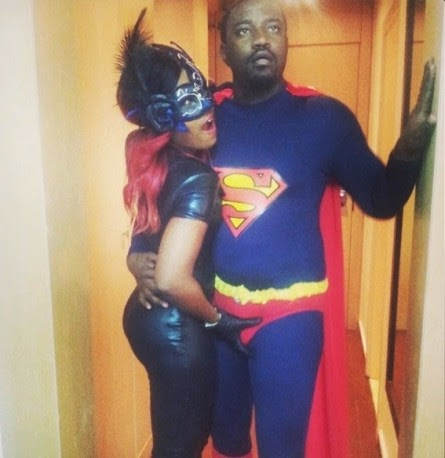 John Dumelo poses with Yvonne Nelson in Superman costume