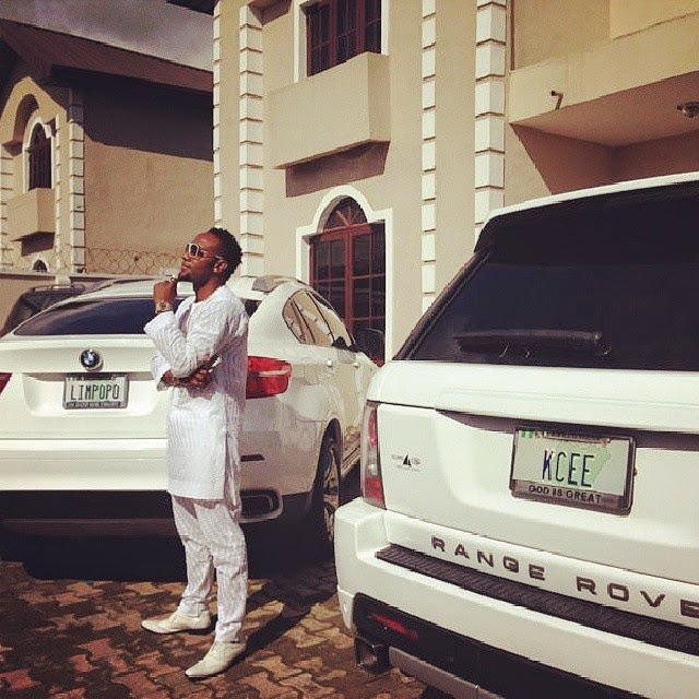KCee poses next to his state of the art cars