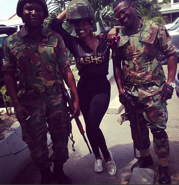 Annie Idibia poses with hunky men of the Nigerian army