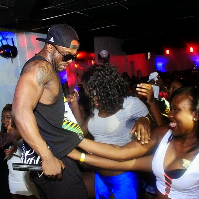 Iyanya shares photos of girls caressing him on stage