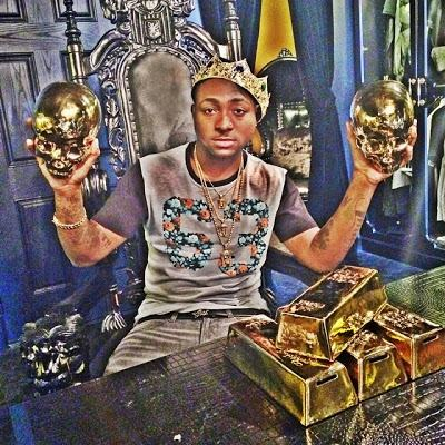 Davido rocks gold crown