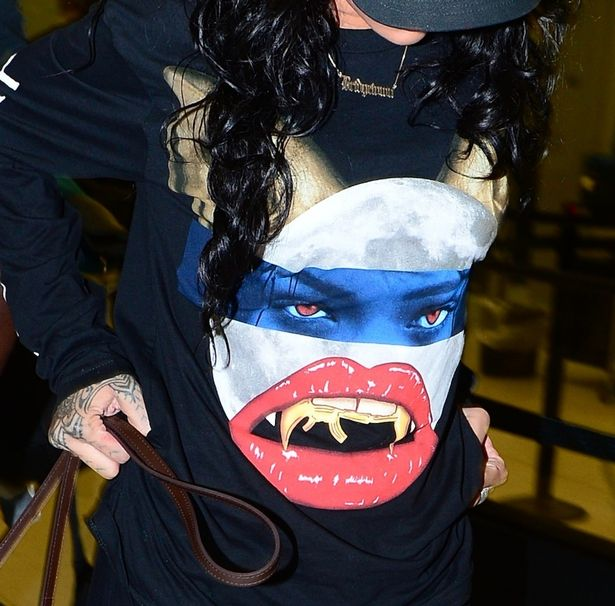Rihanna promotes her Monster Tour with new apparel as she arrives in NYC