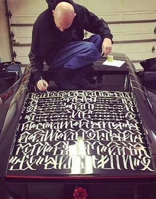Huero hand paint lyrics from Tupac song's, Lord Knows all over his $500,000 Lamborghini