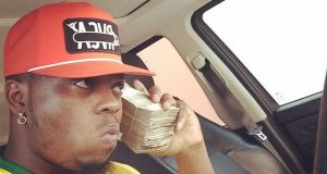 Olamide flaunt stacks of Naira