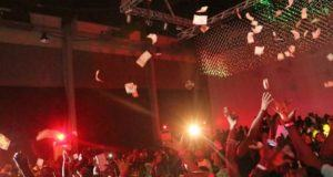 Wizkid spray money while performing at The Hennessy Artistry