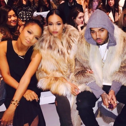 Chris Brown and boo Karrueche in matching fur outfits
