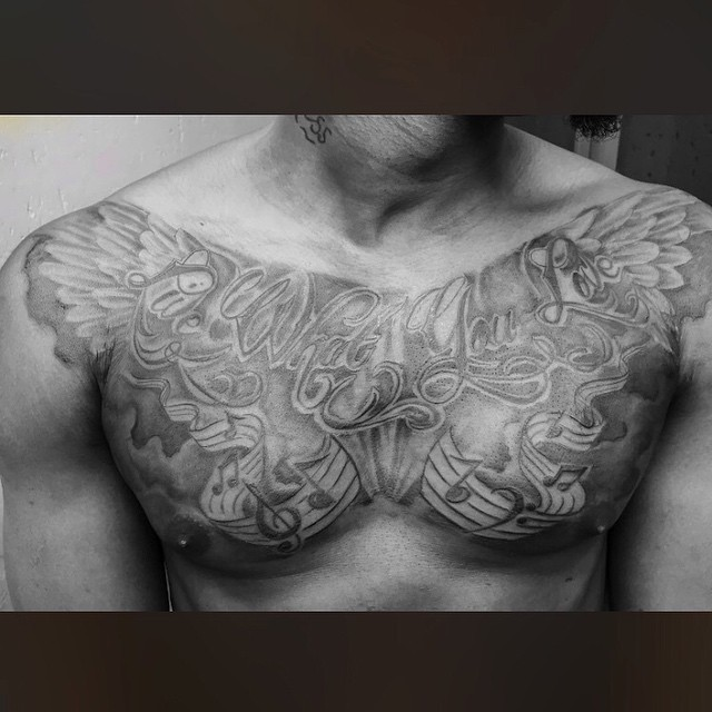 Sean Tizzle Has A New Tattoo On His Chest