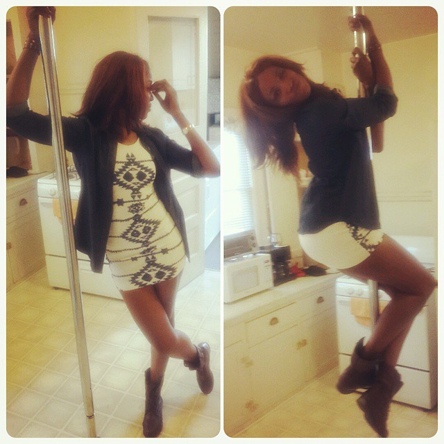 Seyi Shay hanging from a stripper pole