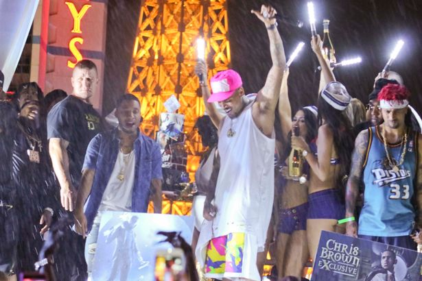 Chris Brown falls off stage during birthday party