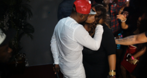 Sean Tizzle Kisses Female Fan Passionately During Performance In New York