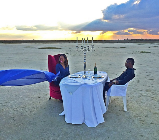 Wizkid and Tania Omotayo having romantic dinner in the middle of a dessert