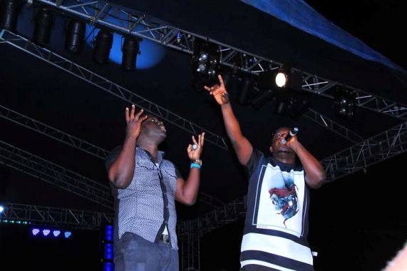 MI gives out his gold watch to a fan on stage in Makurdi