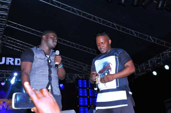 MI gives out his gold watch to a fan on stage