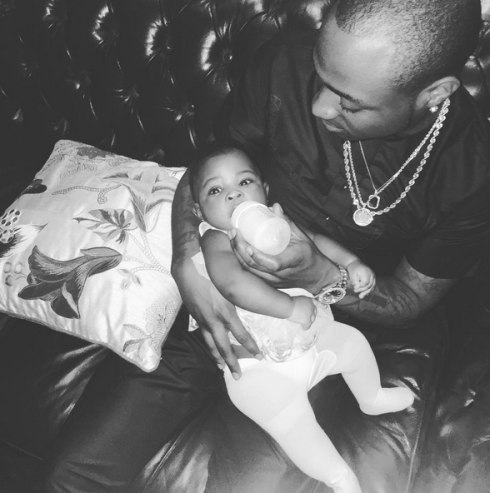 Davido feeding his daughter