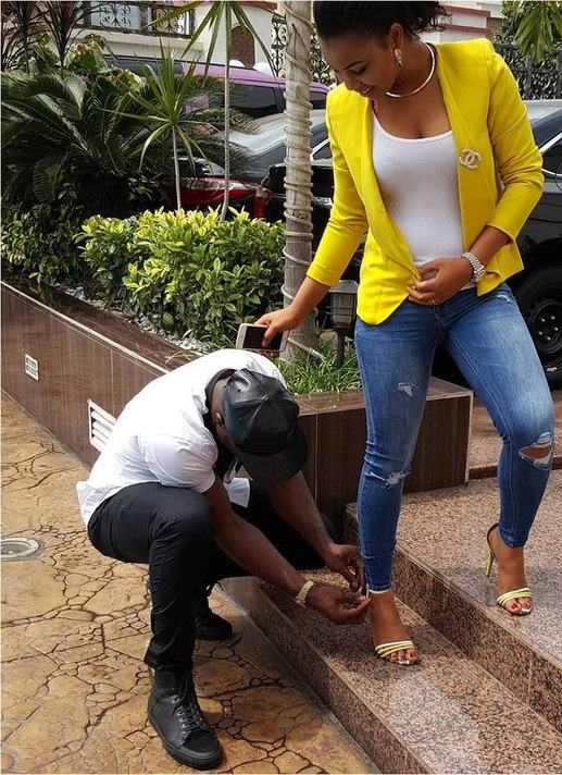 Harrysong Pictured Buckling His Girlfriend's Heel Sandals