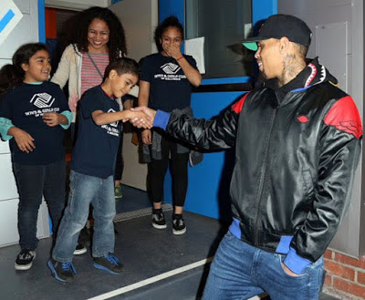 Chris Brown gifts family with a car and gifts for Christmas