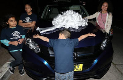 Chris Brown gifts family with a car
