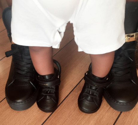 Tiwa Savage shares cute leg pic with her son.