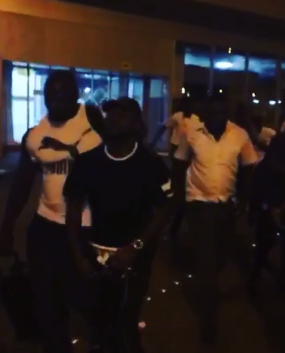 Davido Throws Money In The Air For Fans At Lagos Airport