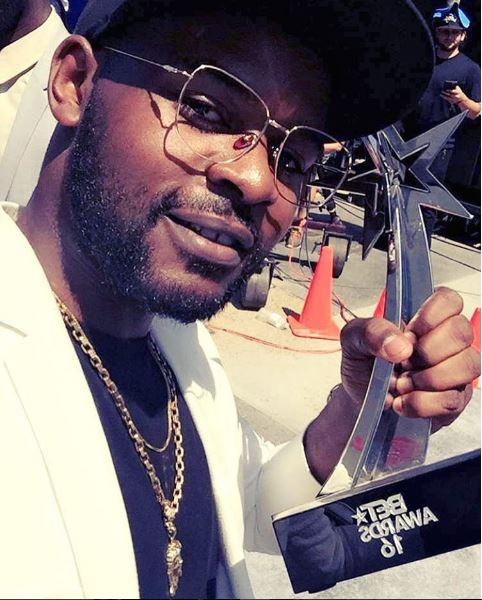 Falz Pictured With His BET Award Gong