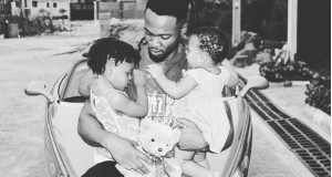 Flavour pictured with his two daughters