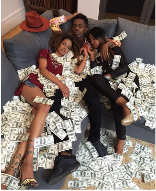 Patoranking Covered In Dollars