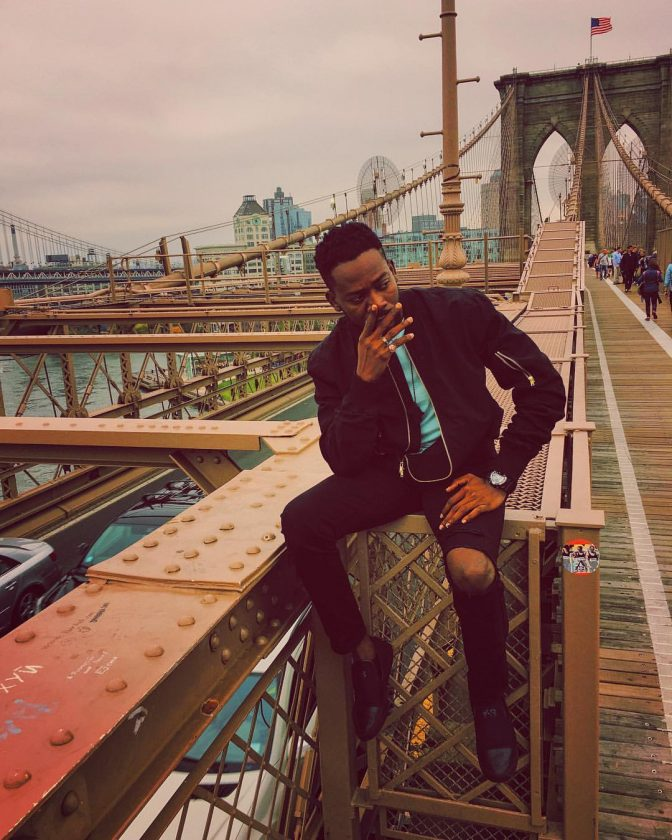 Adekunle Gold Takes Dapper Photo At Brooklyn Bridge