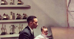 John Legend and Luna playing the piano