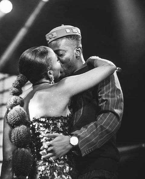 Adekunle Gold gives Simi a kiss after his concert