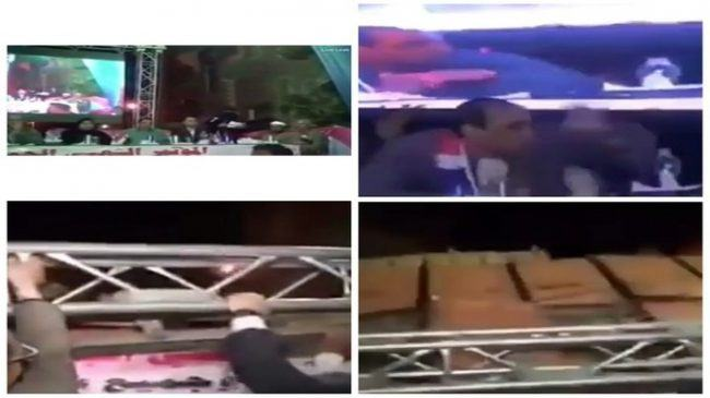 giant tv falls on egyptian politicians