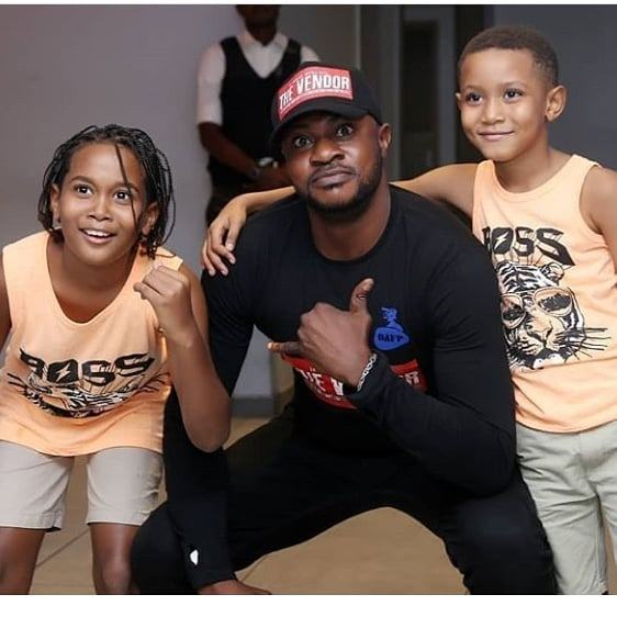 Odunlade Adekola and his kids