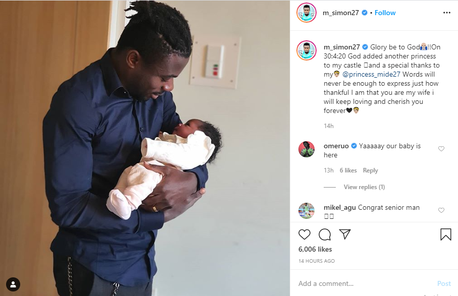 Moses Simon and his baby